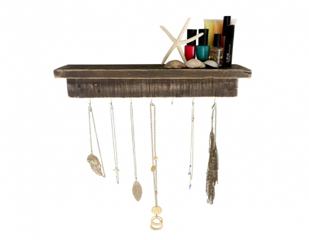 Designed as a creative necklace holder from reclaimed wood with primary color brown.