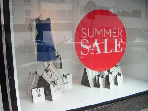 Just a simple organized window display with a big red dot to announce summer sales.
