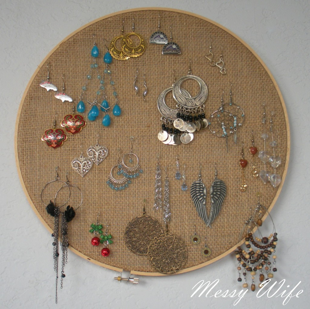 A creative jewelry earring holder seems to be made of sail and placed in a round frame.