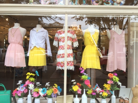 This is one simple way to decorated the summer window display, with flowers and a few adorable dresses.