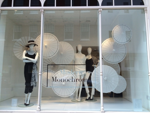 Monochrome designed for summer something simple, yet sophisticated with a few white umbrellas in the window display.
