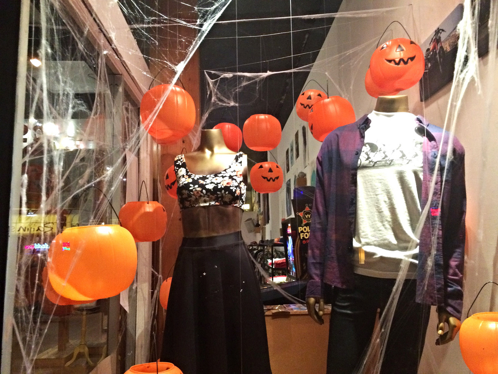 A few plastic pumpkins, some spider web and fashion, this is the meaning for a Halloween window display at this store.