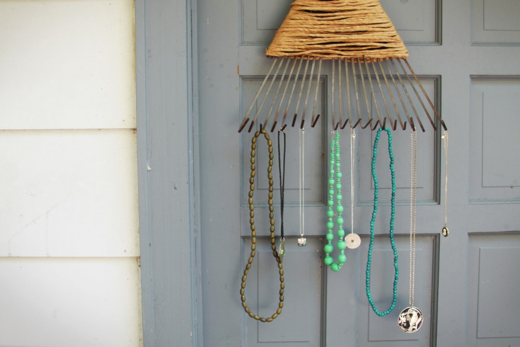 You can have a creative jewlery necklace holder, by taking some iron strips and bent them, then bound them together with a thin rope.