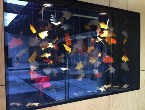 Simple yet charming window display for autumn, just with a few fallen leaves.