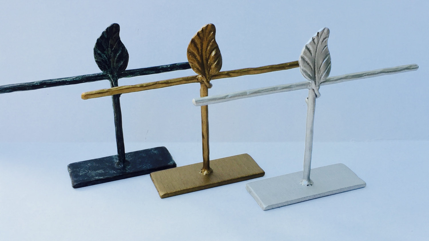 This beautifully textured steel, is perfect as a jewelry bracelet holder, having a place for multiple pieces.