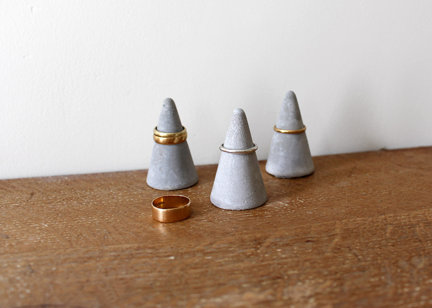 Three stones in a conic shape is a creative way to design a jewelry holder, especially for rings.