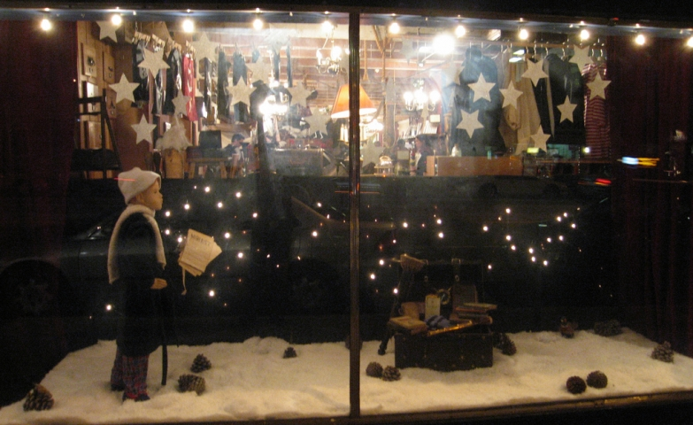 In Valencia, the mannequin child from the window display is ready to send the letters to the Santa, the snow is on the floor and the stars are shining bright in the sky like it has to be in the winter.