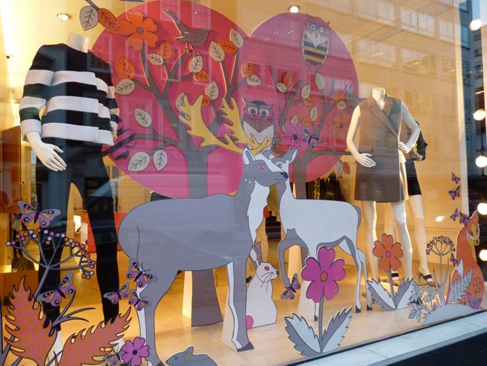 Stella McCartney store has some cute stickers with various animals for the autumn window display.