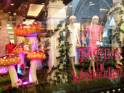 This is a store with a wonderland theme, magic shrooms and magic idea for a summer window display.