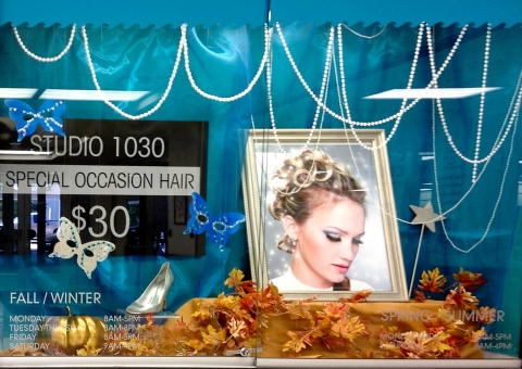 A studio that was inspired by cinderella story, designed its autumn window display with golden pumpkin and leaves.