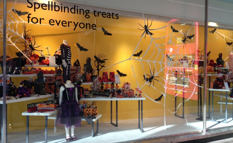 Tricks and treats for kids, bats and spider stickers on the window display for  Halloween celebration.