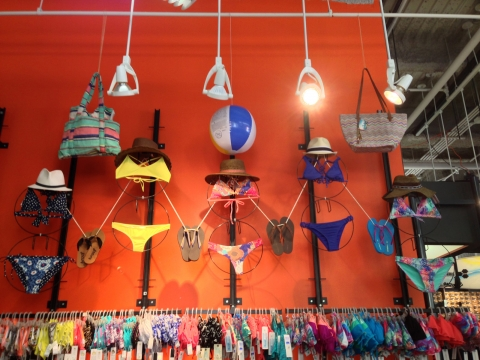 Representative easy summer window display, with summer elements, like swimsuits, flip flops and more.