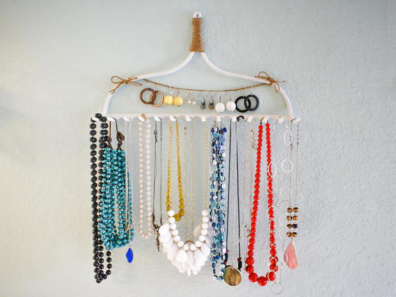 Someone made something creative with this white hanger. They transformed it into a jewelry necklace holder.