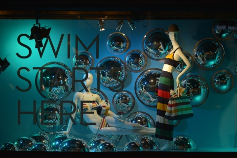 Swim starts here, in this window display designed with bubbles and swim equipment.