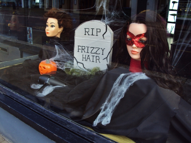"At Verelle hairdressing Halloween is totally there with a pumpkin in the window display, a crypt from where you can read ""rip frizzy hair"" and some spiderweb."