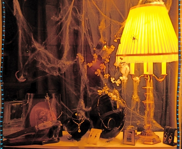 A victorian parlor, spiderweb and jewelers for Halloween window display.