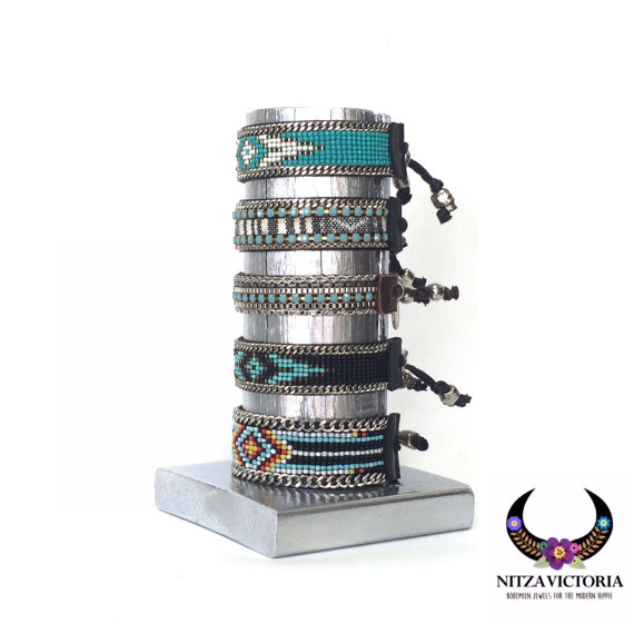A creative jewelry bracelet holder made of wood and painted with matt silver.