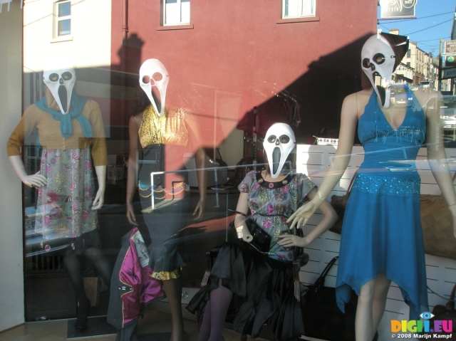 "Take a ""whats up"" death mask, place it on the mannequin's face and you can have the most simple Halloween window display."