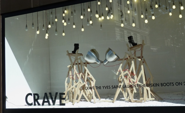 Hanging light bulbs at Yves Saint Laurent could form a modern concept for autumn window display.