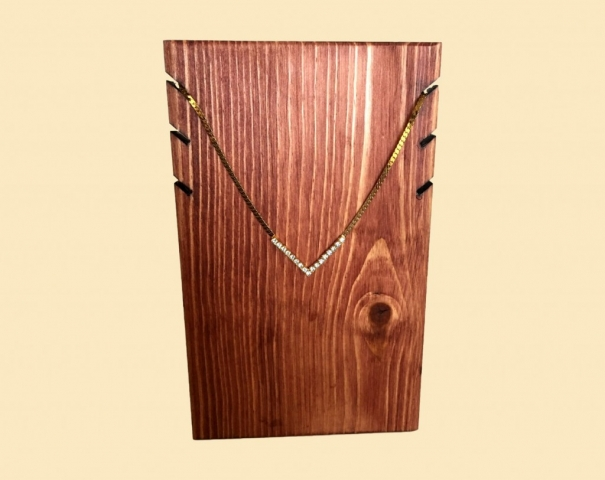 Creative and also simple this necklace holder is made of wood, stain and paint and offers you an elegant way to hang your jewelry.