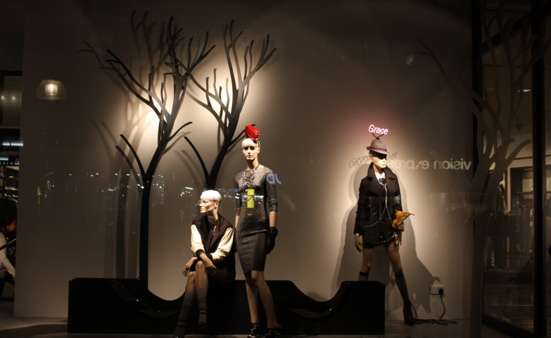 Zara has a simple window display with a few empty trees in the background for the thought of autumn.
