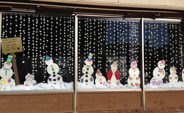 A winter wonderland with many snowmen, some happy, others sad.