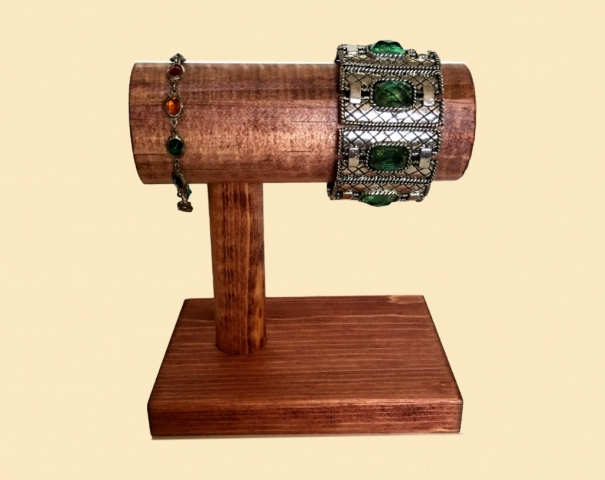 Sturdy and durable yet lightweight, this is a creative T-bar used as a jewelry bracelet holder, made from solid wood, stain and tint of gold paint.