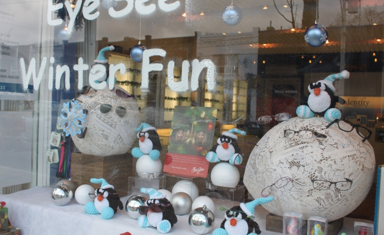 """This winter window display, delight our view with a game of words """" Eye see winter fun"""" and plush penguins, suggestive for the cold weather."""