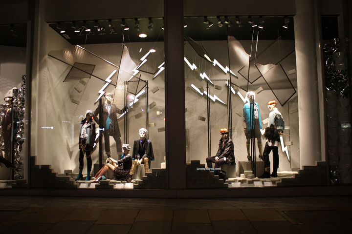 Zara from Oxford Street designed the autumn window display with illuminated thunders and a gray background.