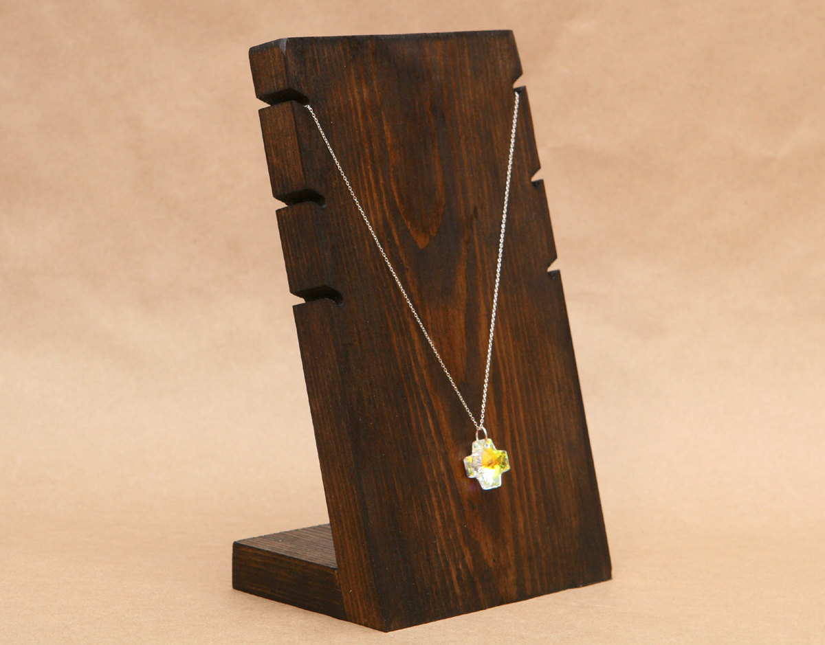 With a vintage air, this creative necklace holder made from wood, will allow you to put three jewelry on it.