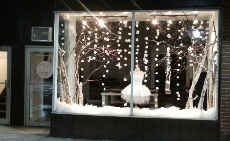 A white tutu in this YM boutique winter window display, looking fragile and soft like the snow.