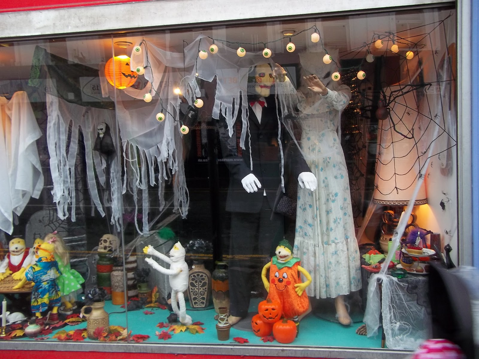 A classic Halloween window display with white sails and zombies.