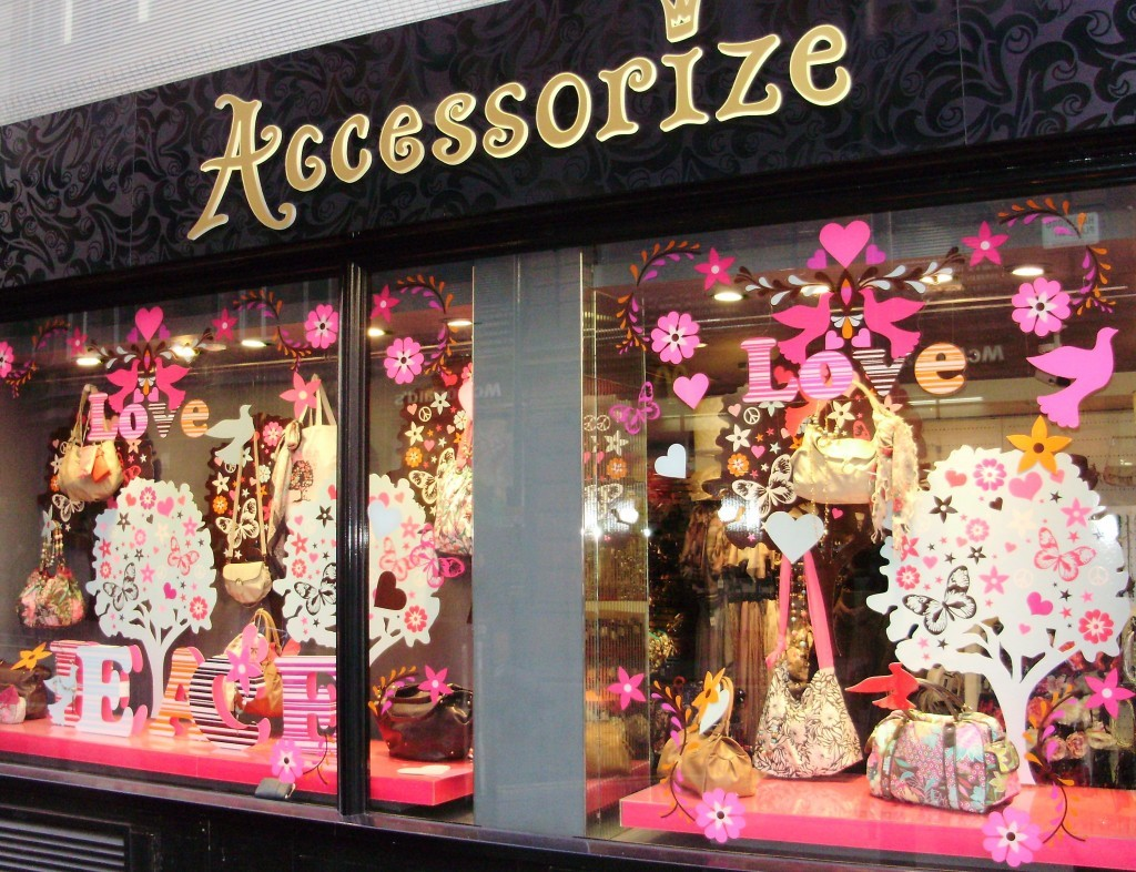 Accessorize is ready for the month of love, called Valentine's day, with pink birds, flowers stickers on the window display.