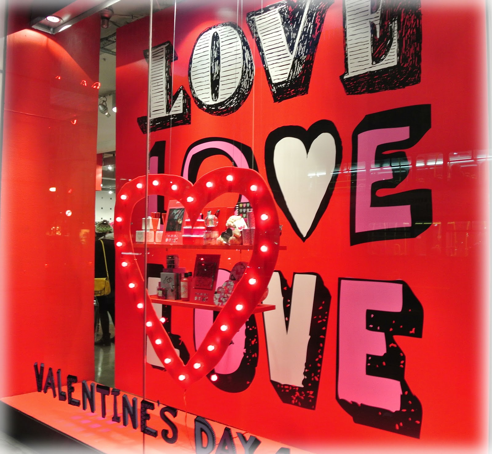 "This window display background for Valentine's day, makes me think about a very popular song which sounds like ""All you need is love""."