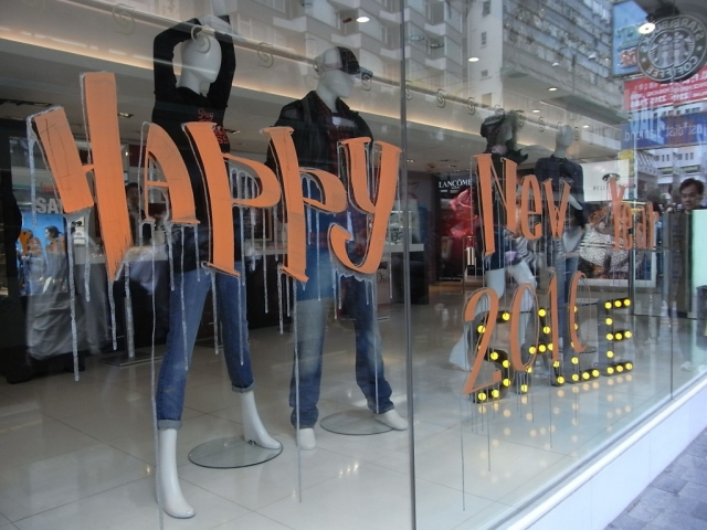 Mannequins in jeans and a black t-shirt, and a sticker message on the window display going well with the New Year's Eve.