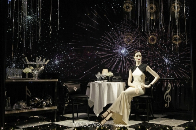 Ralph Lauren has a back and sparkly background for their New Year's Eve window display, also champagne and the fire-crackers are spicing up the place.