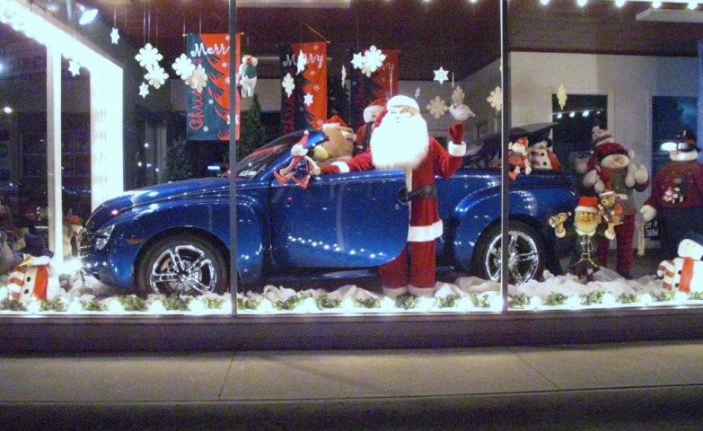 This window display may suggest a good present for Christmas, a gorgeous blue car accompanied by Santa.