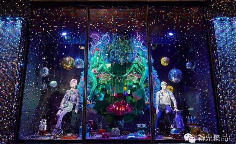 Another Harvey Nichols Christmas window display, decorated with blue lights, disco balls, and many presents.