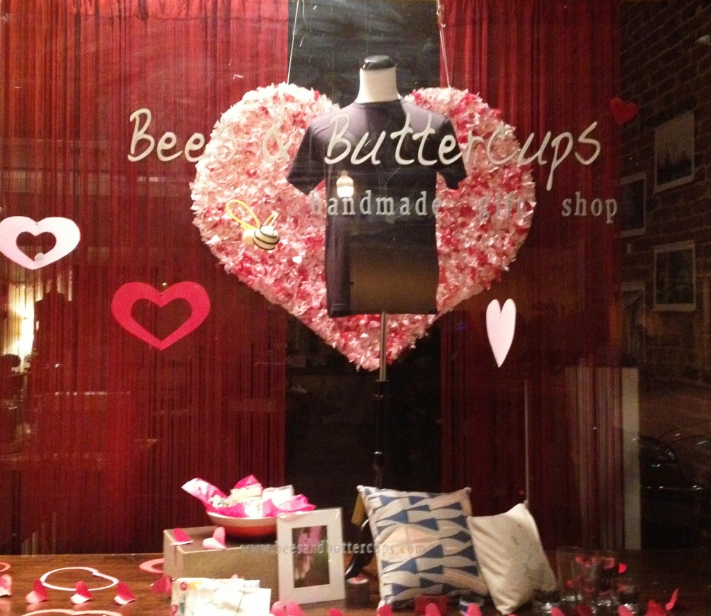 In this Valentine's day window display, we have a big red and pink hanging heart, and a few heart stickers.