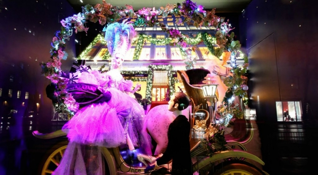 """This New Year's Eve window display should be named """" Once upon a time"""" because it has a fairytale scene in which a princess is getting down from a clash, waited by a prince."""