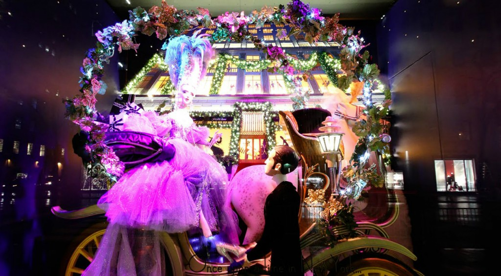 "This New Year's Eve window display should be named "" Once upon a time"" because it has a fairytale scene in which a princess is getting down from a clash, waited by a prince."