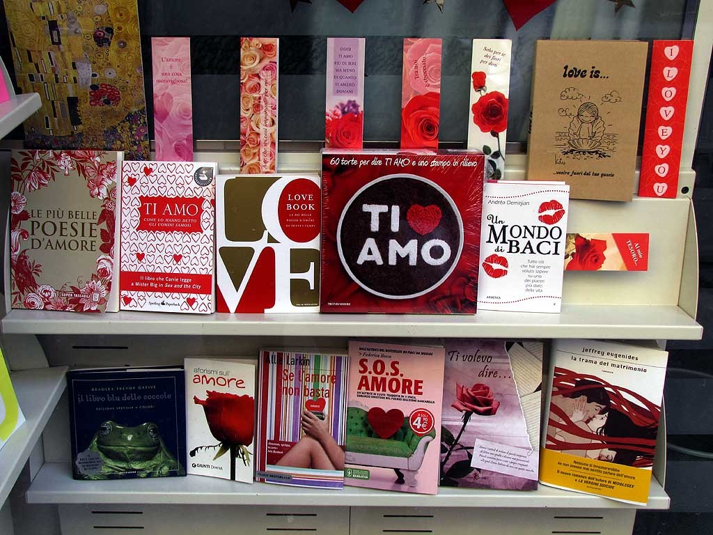 A bookstore with a window display full of romantic novels and love books, for Valentine's day.