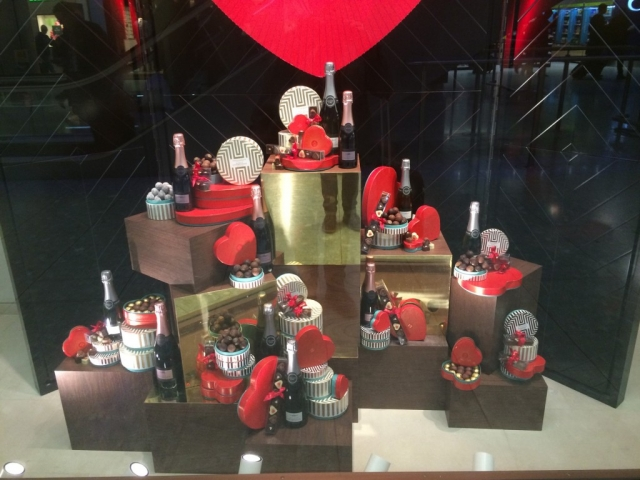 Festive arranged, this window display has chocolate boxes and champagne for a proper Valentine's day.