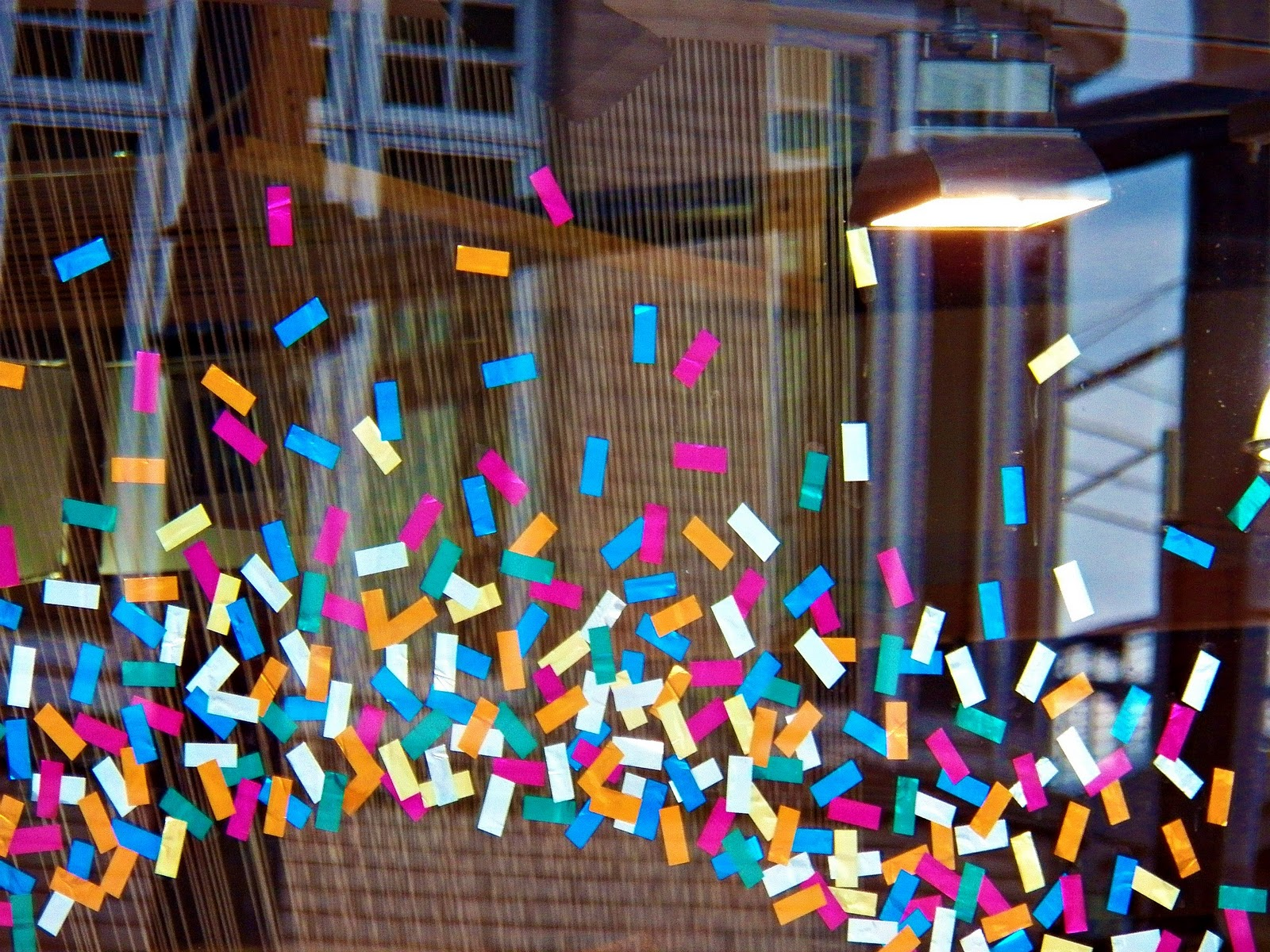 If you want to see something simple in a window display but also representative, what could better represent a New Year's Eve party than confetti clusters?
