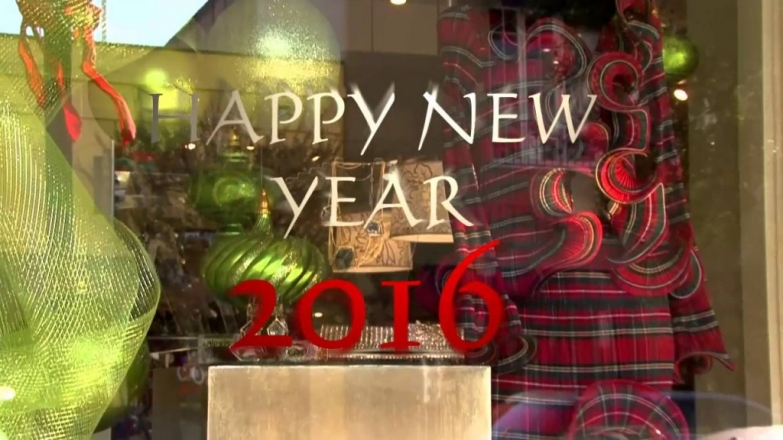 The curtain with more pink patterns and the message sticker from the window display are thrown out into relief that it's New Year's Eve.