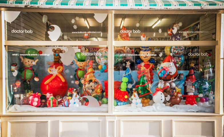 Doctor Bob has a funny Christmas window display, made almost entirely of balloons characters, like Santa's elves.