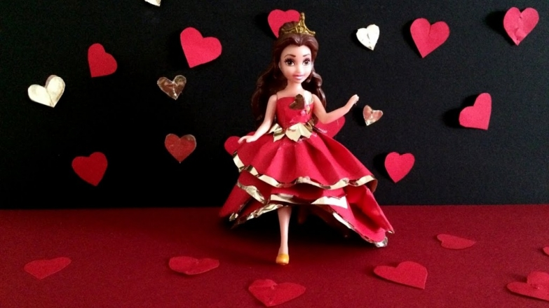 A closer look at Valentine's day window display, where we can see a black background with paper hearts and a Cinderella doll.
