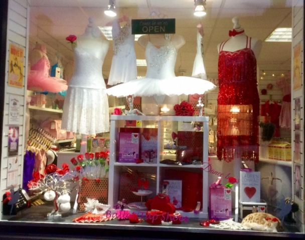 Roses, cards and Valentine's day dancing dresses, all these beautiful things in the window display.