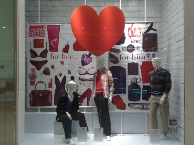 At Debenhams, the concept of love presented for Valentine's Day can be seen in the window display, with a big red heart sticker on it.