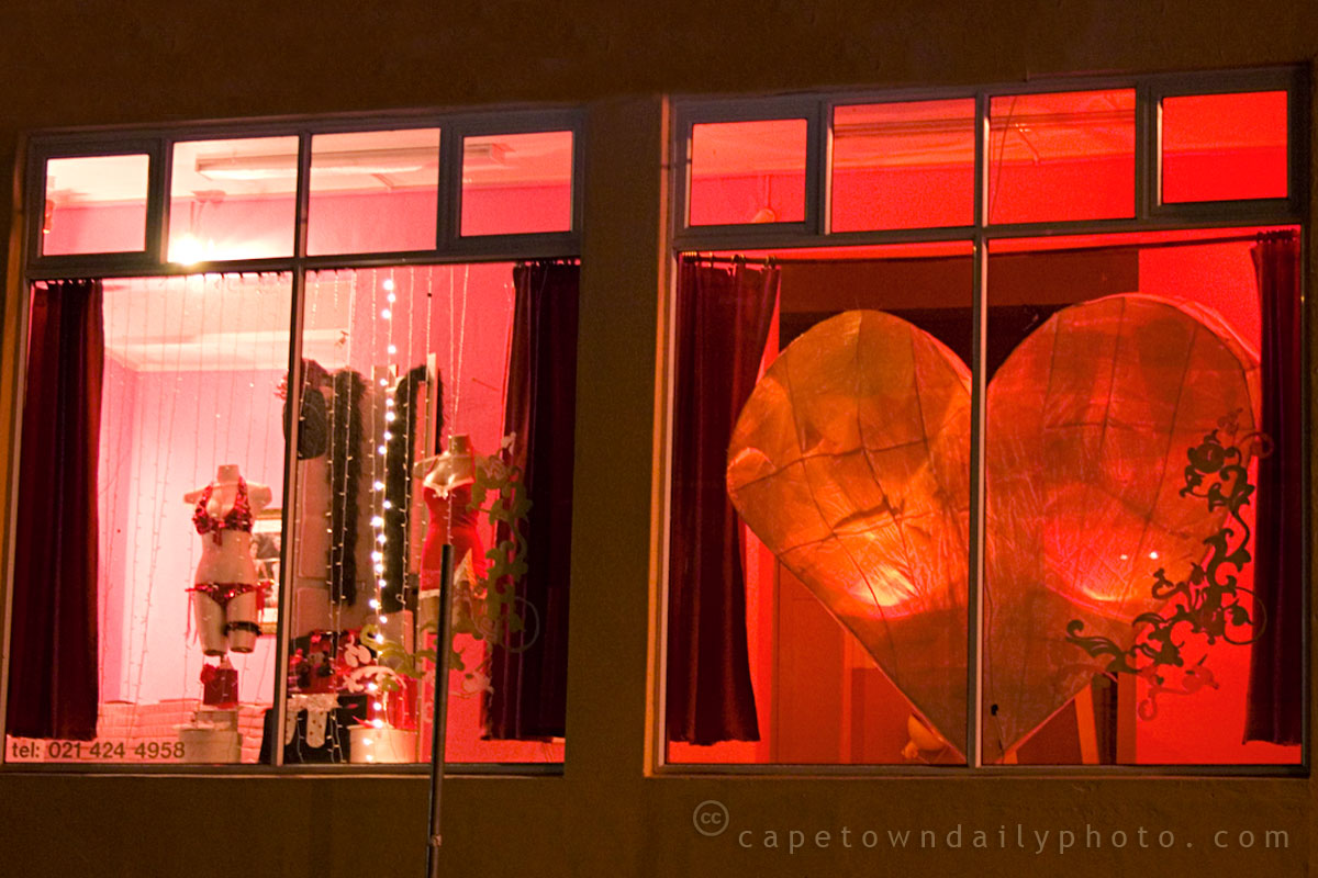 We can observe a romantic atmosphere in this Valentine's day window display, with dim light and red lingerie.